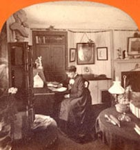 Louisa May Alcott at her desk at Orchard House