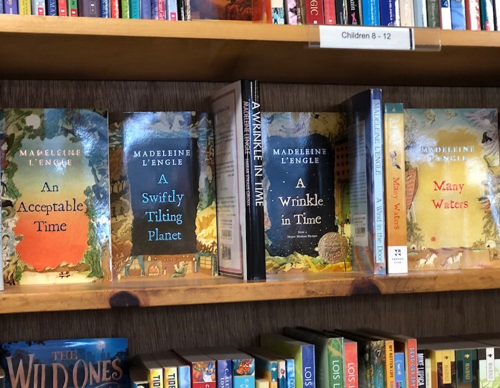 Madeleine L'Engle books on a bookstore shelf