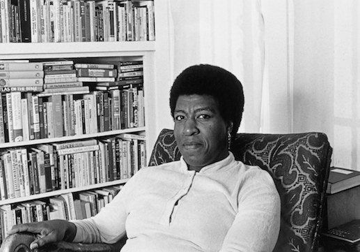 Octavia Butler at home with books