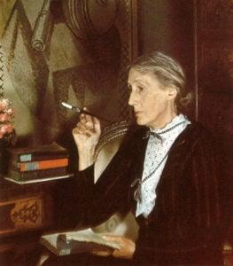 Virginia Woolf smoking at her desk