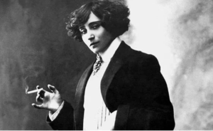 Colette in men's clothes