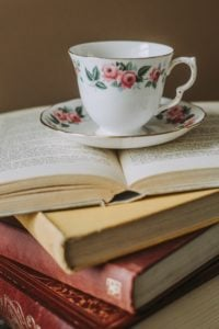 teacup and books by anete lusina
