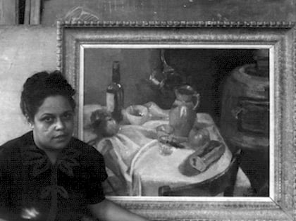 Gwendolyn B. Bennett with one of her paintings