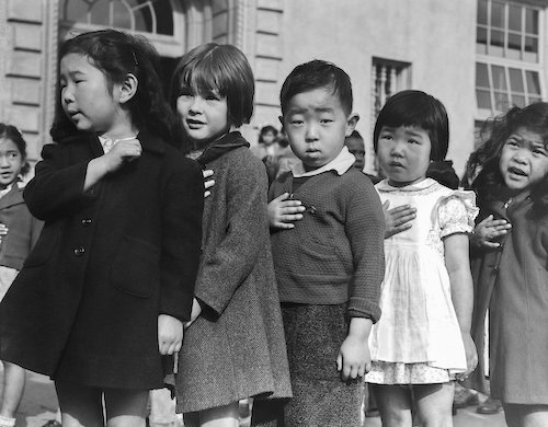 Japanese children pledging allegience at an internment camp - photo by Dorothea Lange, 1942