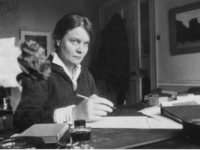 Iris Murdoch at her desk, photo by Steve Brodie