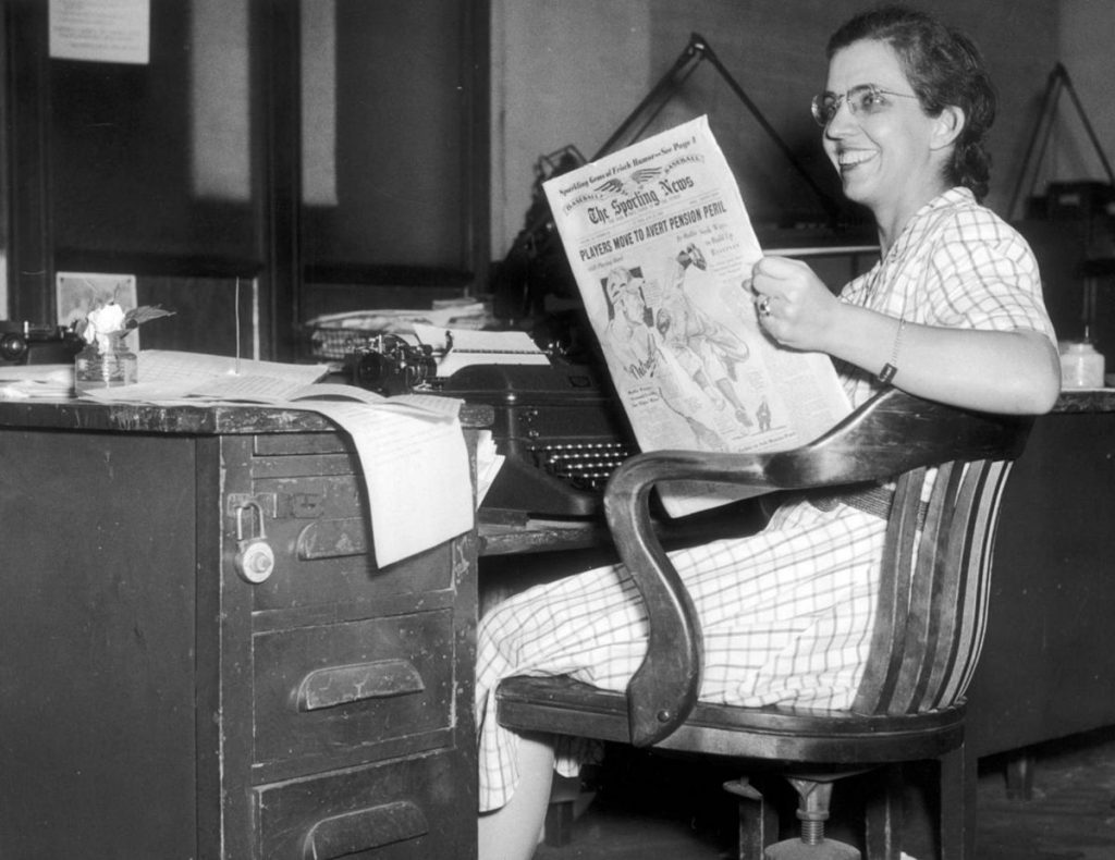 Mary Garber, sports journalist, at her desk
